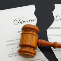 Gavel resting on divorce decree.